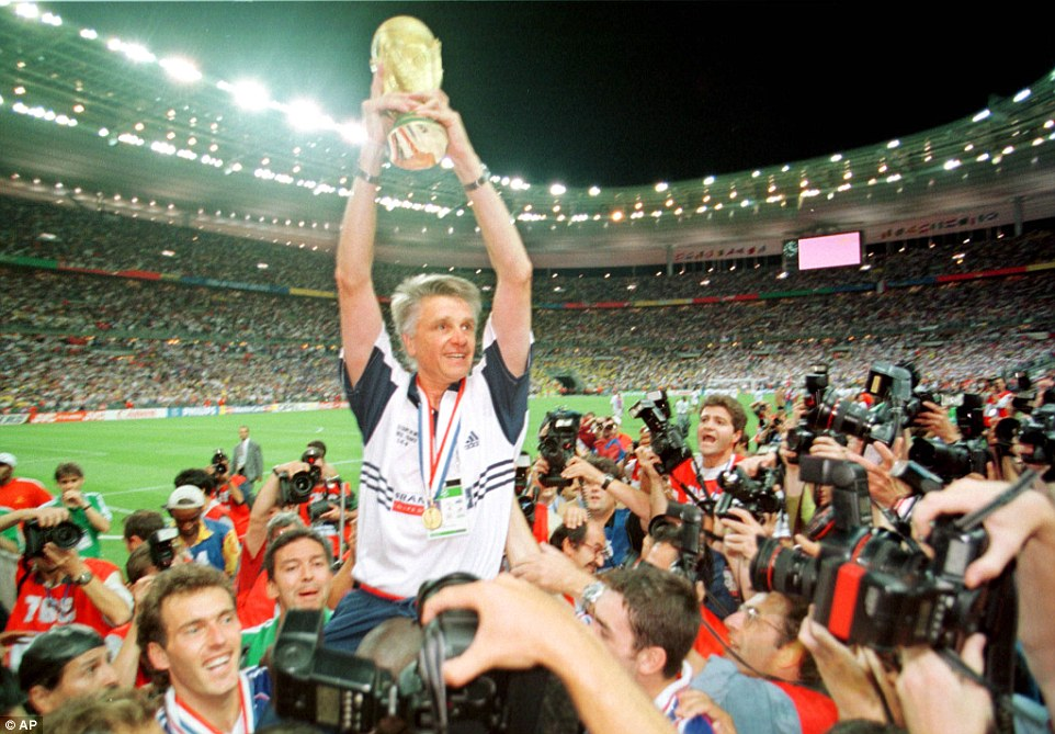 Coach Aime Jacquet is hoisted by Laurent Blanc and other members of the France team as he shows off the trophy following France's triumph