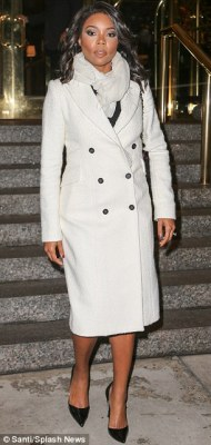 Cozy: The actress donned a cashmere grey double-breasted coat and matching scarf