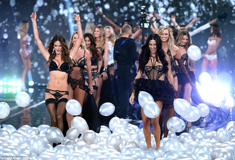 Here come the girls! Balloons fell from the ceiling as they made their final lap of the catwalk