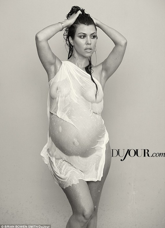 'Enpowering': Another image published on DuJour.com showed Kourtney in a wet shirt