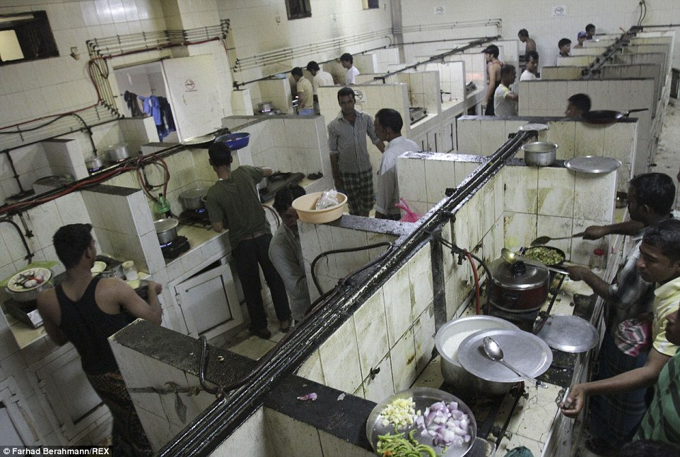 An Iranian photographer has captured the harsh lives endured by the migrant workers building Dubai's ever-growing skyline. Pictured is a huge dirty kitchen at the Sonapur camp where many of them live. The gas pipelines were built by the labourers and not subject to safety laws