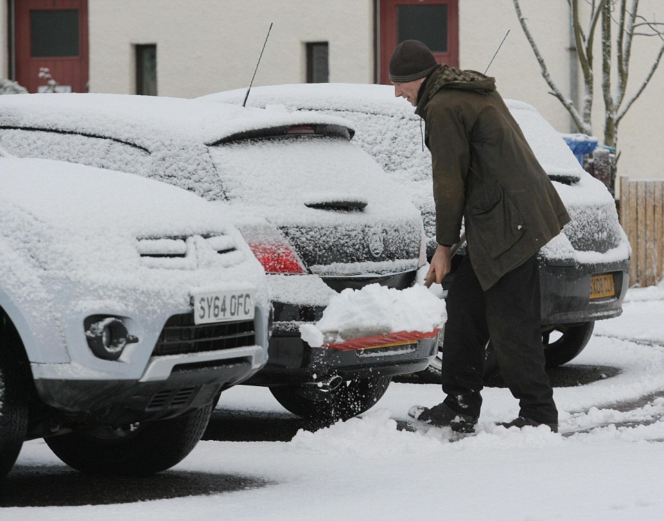 Snowfall: Severe weather warnings for snow and ice are in place for the north west of England, most of Scotland and Northern Ireland today, with forecasters predicting snowfall accumulations of between 5cm and 10cm. Pictured: A man clears snow from his drive in Tomatin, Scotland