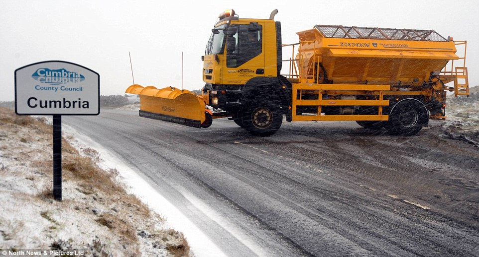 Gritting: Councils up and down the country deployed gritters across major roads today as snow hit the north of England and Scotland