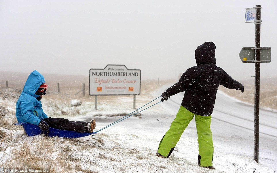 Playtime! Alex Kingston, eight, enjoyed a sledge ride with a friend in Northumberland today as blizzard-like conditions hit the north of England