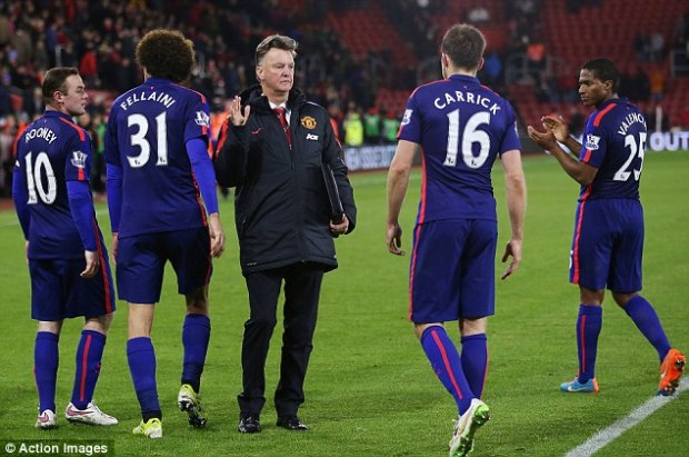 Louis van Gaal slaps the hand of Carrick after United's 2-1 win away at Southampton on Monday