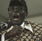 Zimbabwean President, Robert Mugabe, delivers his speech on the last day of the  Zanu pf 6th National Congress in Harare, Sat, Dec, 6, 2014. Mugabe, 90, was re elected as leader of the party for another 5 year term and his wife Grace confirmed  as leader of the powerful Women's League. (AP Photo/Tsvangirayi Mukwazhi)