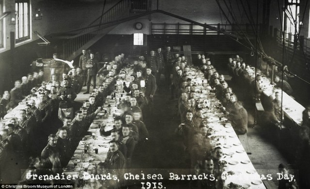 Mrs Broom initially printed her images, such as this one of Grenadier Guards raising a glass at Chelsea Barracks in 1915, on postcards