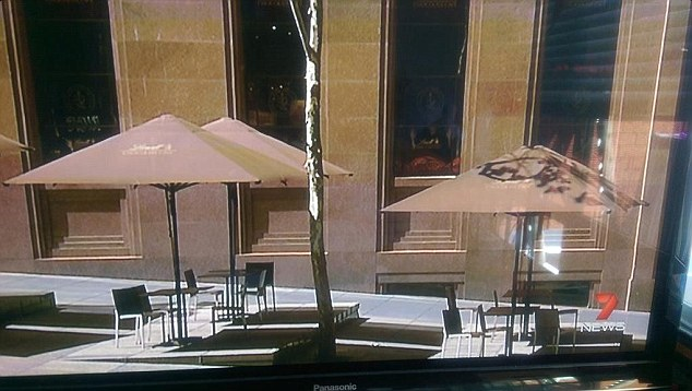 Hostages: People could be seen with their hands pressed against the window of the Lindt cafe in Sydney