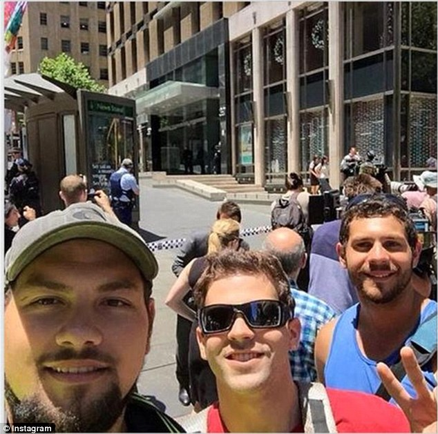 These three men also looked pleased to be in Martin Place despite the chilling circumstances
