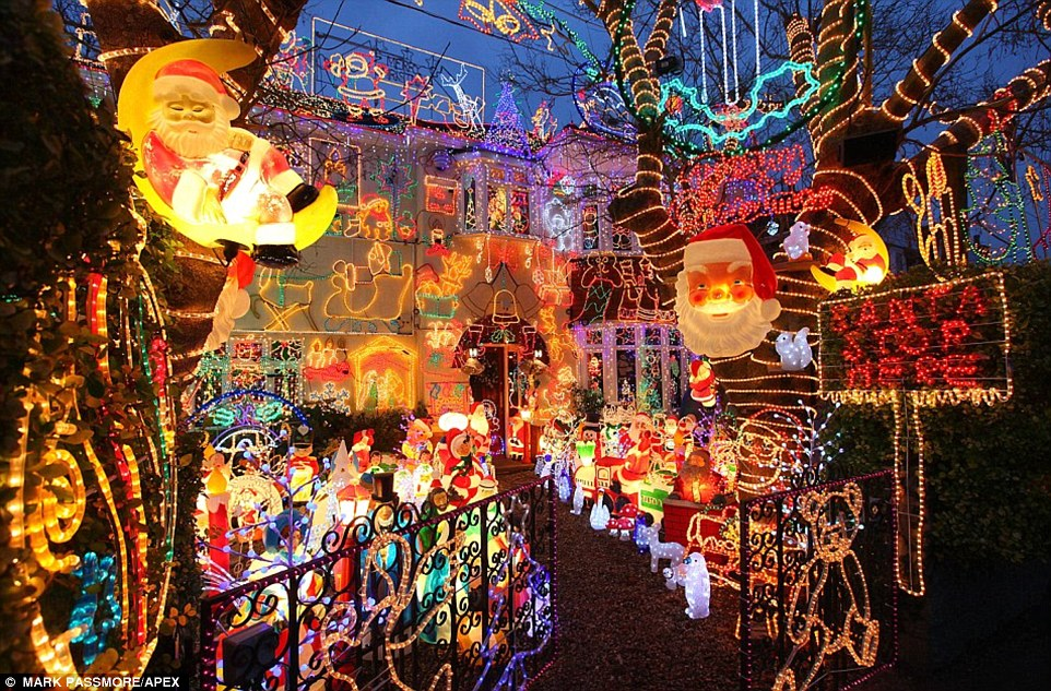 Alex Goodhind decorates his home in Melksham, Wiltshire, with more than 200,000 lights to raise money for hospice where his mother was treated before she died