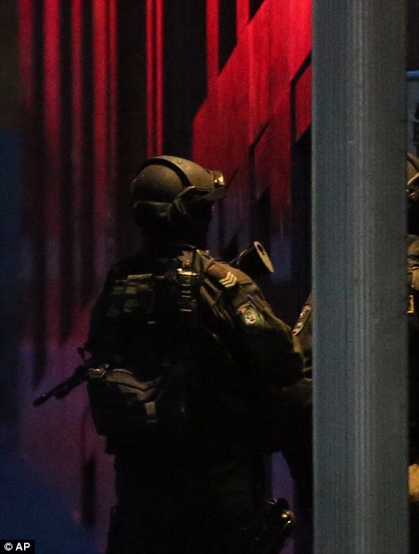 Heavily armed police remained posted around the cafe as night fell and the hostage drama continued into the night