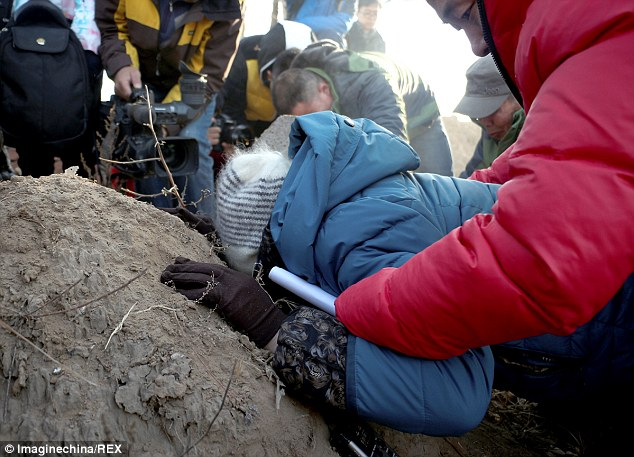 Hugjiltu's mother falls upon the grave of her son, branded a rapist after his wrongful conviction for murder