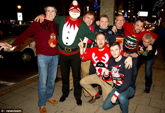 A group of friends in a full range of festive Christmas jumpers show off their seasonal wear for the cameras