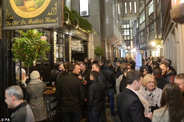 In London, drinkers take a civilised approach and sip on their beverages on the last Friday before Christmas