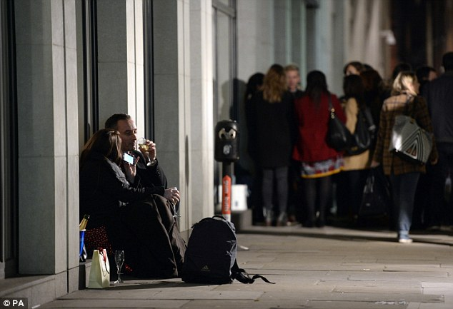A man and woman share a quiet bottle of champagne away from the crowds in central London