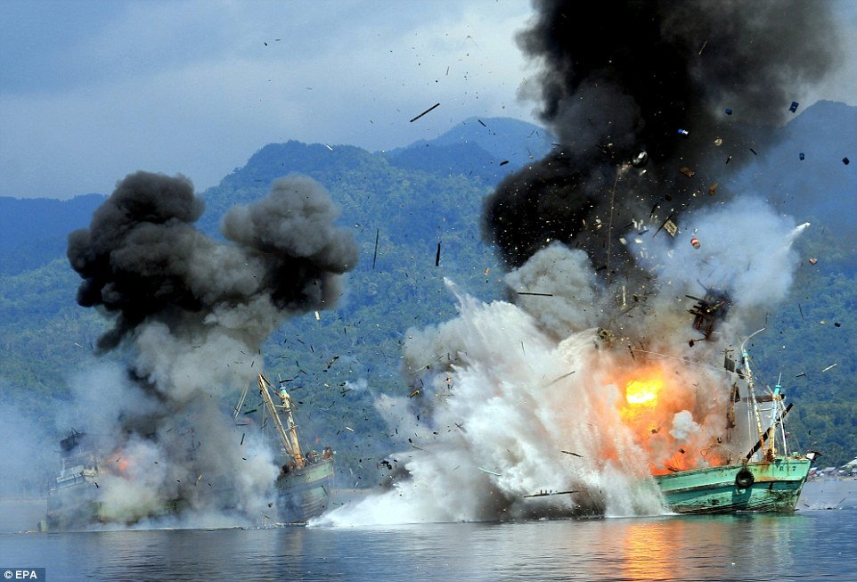 Extreme prejudice: A pair of Papa New Guinea-registered ships are destroyed by the Indonesian Navy after they were caught poaching fish in the nation's waters. Indonesia is cracking down hard on illegal fishing and has destroyed a number of ships so far