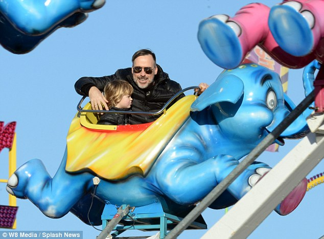 Big kid: The star appeared to be enjoying the ride considering more than even his young son