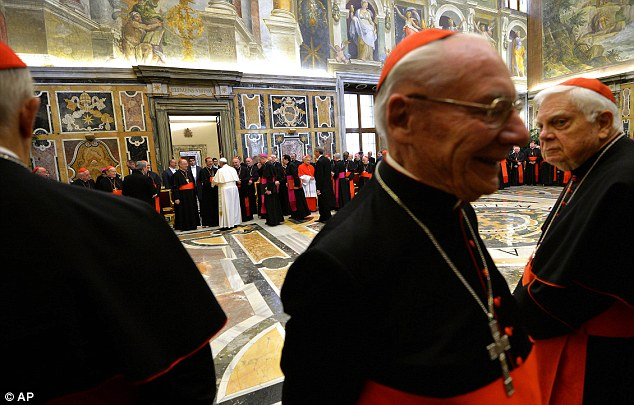 Muted applause: Few were smiling as Francis listed one by one the 15 'Ailments of the Curia' that he had drawn up, complete with footnotes and Biblical references