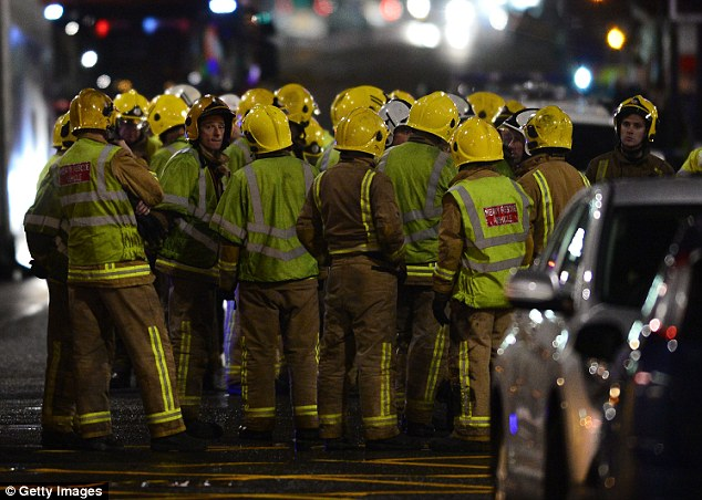 Rescue workers at the scene of the horror crash last night. Police have confirmed six people died