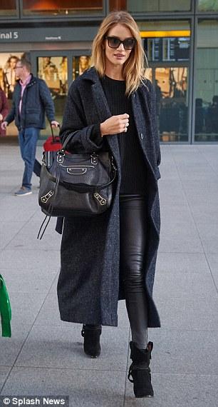 Rosie Huntington Whiteley Arrives At LAX Wearing Dark Grey