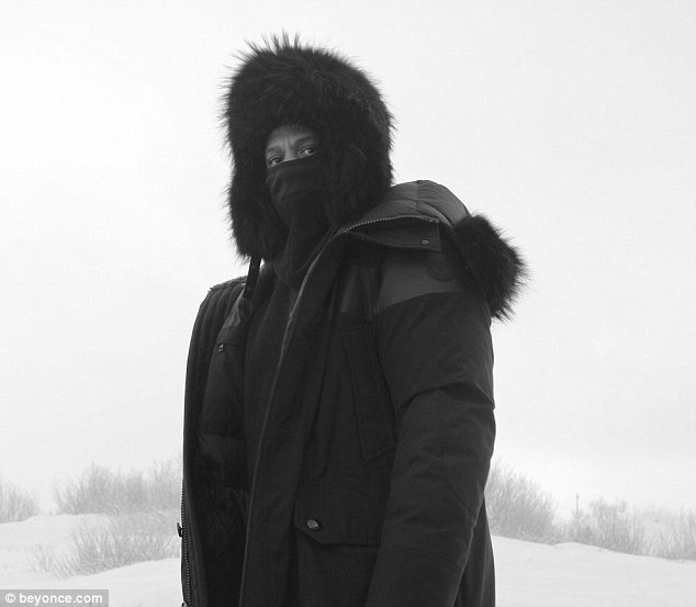 On the run: The hip hop icon bundled up for the cold