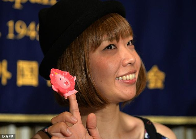 Japanese artist Megumi Igarashi shows a small mascot shaped like a vagina at a news conference in Tokyo