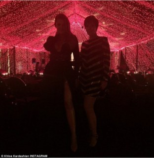 Ready to party: Khloe posed with host extraordinaire Kris Jenner in the beautifully lit marquee