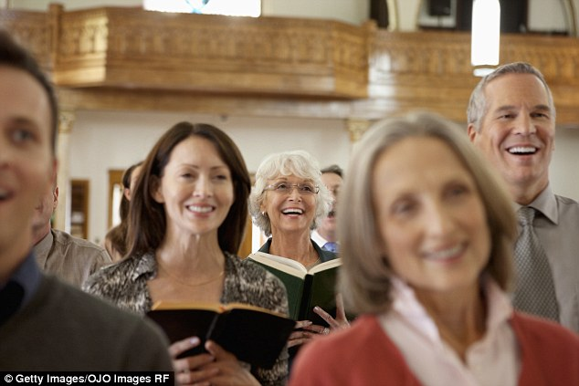 Study: A recent study by the Austin Institute for the Study of Family and Culture found that a strong correlation exists between religious affiliation and personal happiness (stock image)