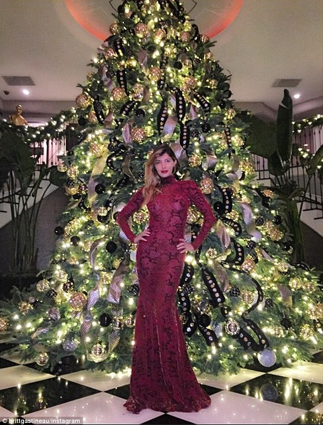 Another look at the looker: Brittny also posed in front of the Jenner tree; her dress was maroon lace