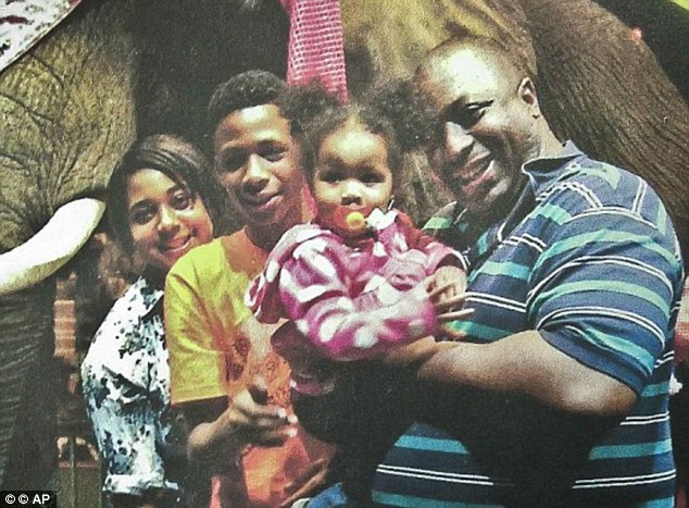 Killed: Garner, pictured with his family, died after a police officer held him in a chokehold in July