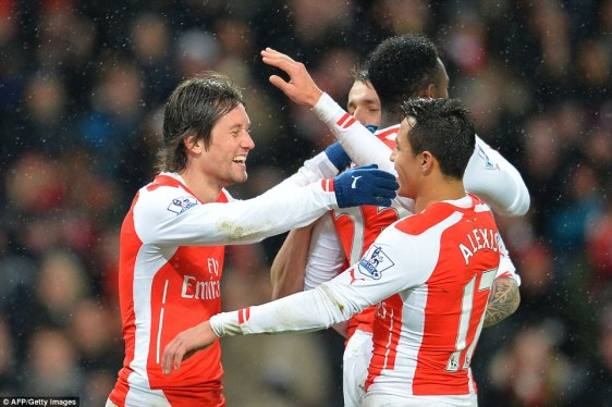 Rosicky (left) is congratulated by his Arsenal team-mates after doubling their advantage at the Emirates