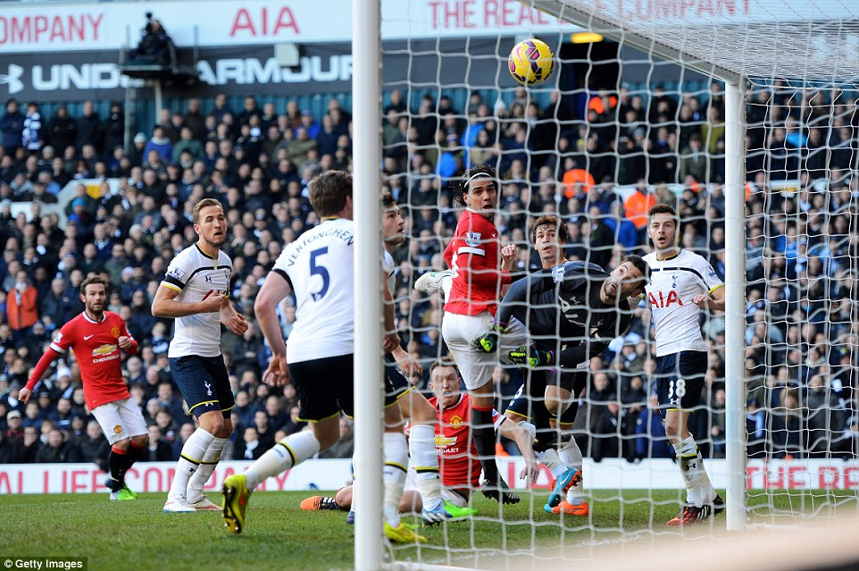 Phil Jones looks on from the floor as his header is palmed over the line by Hugo Lloris, but the goal was disallowed for offside