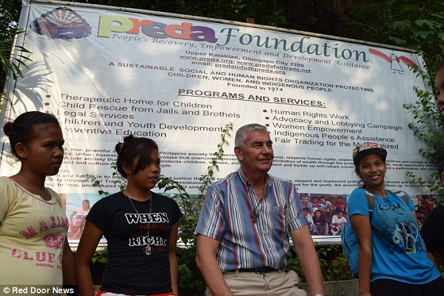 Campaigner: Father Shay Cullen is fighting to have Douglas Slade brought to trial over previous allegations that have now been dropped after Slade boasted of paying his way out of court. Father Cullen trains child welfare volunteers at the Preda Foundation in Subic Bay, the Philippines