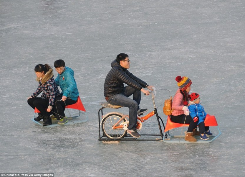 Beijing boating lake freezes solid so tourists take special carts     China traditionally marks the long winter period of cold weather with the  Harbin Ice and Snow