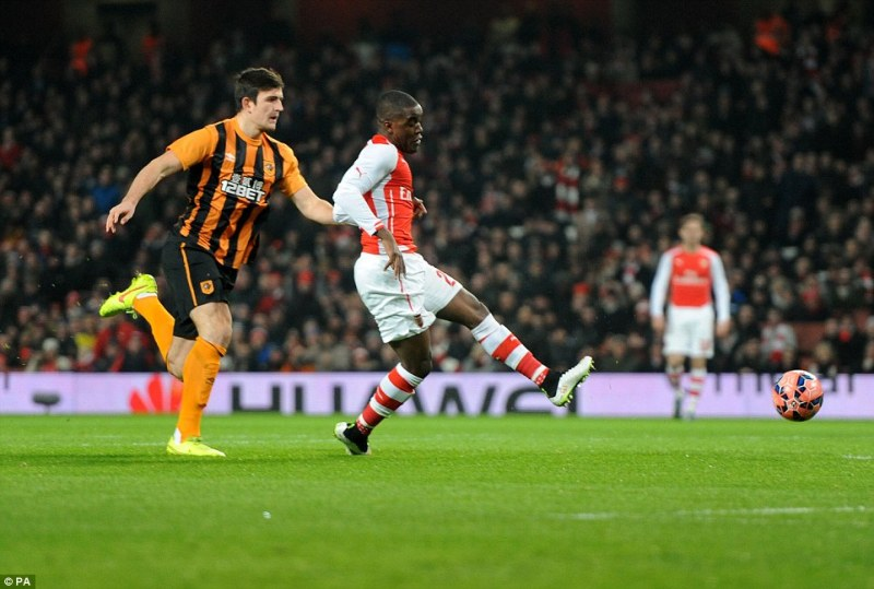 Joel Campbell (right), given a rare start for the Gunners, is denied the opener by a smart save from Steve Harper