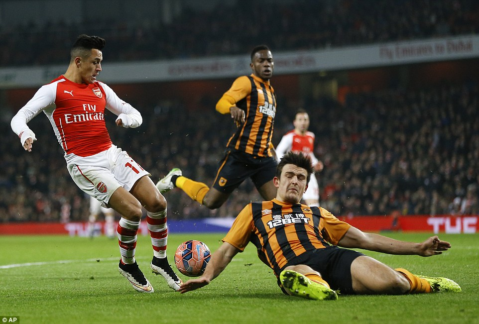 Sanchez has a shot blocked by Hull defender Harry Maguire as Arsenal miss one of many first half chances