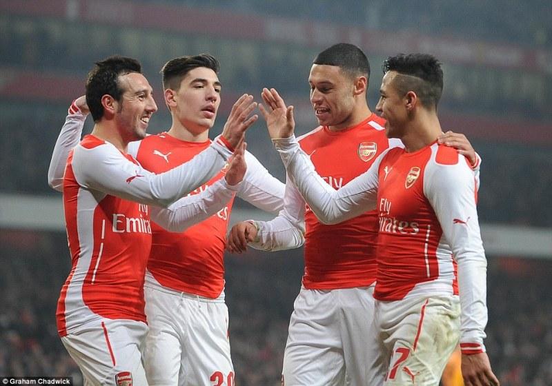 (L-R) Santi Cazorla, Hector Bellerin, Alex Oxlade-Chamberlain and Sanchez celebrate victory at the Emirates Stadium