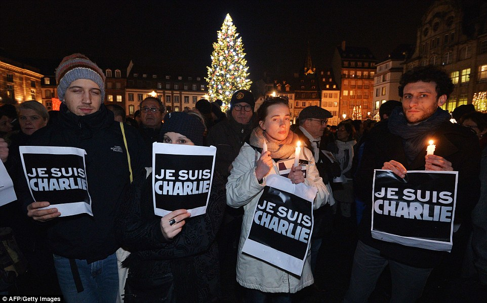 Standing in front of a large Christmas tree in the city centre, protesters gather in Strasbourg, eastern France to show their support