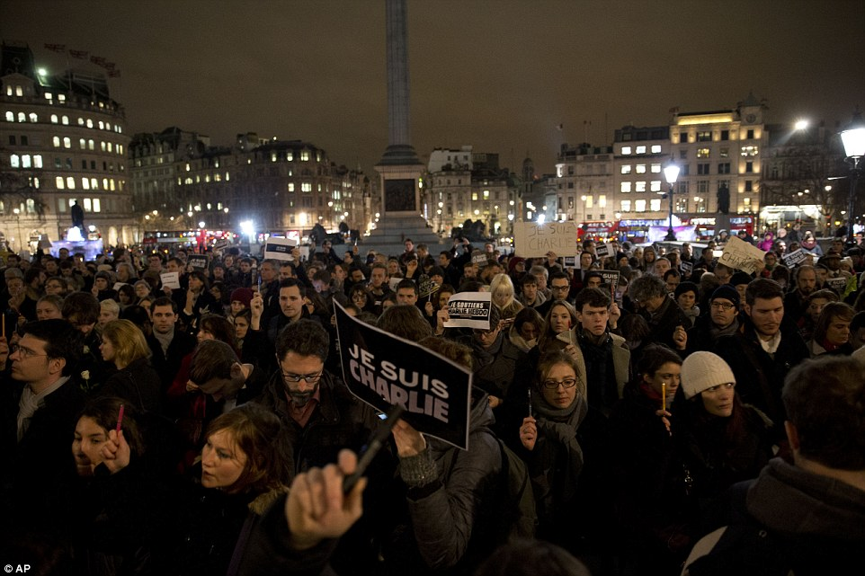 London: The mood was sombre in Trafalgar Square as protesters with posters reading 'Je Suis Charlie' showed their solidarity with France