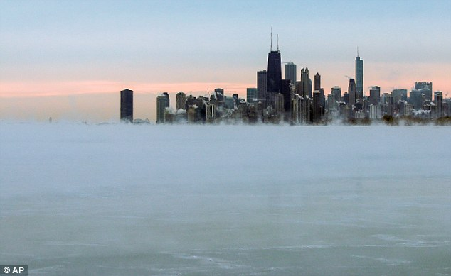Steam rises over Lake Michigan near the Chicago skyline on Thursday. Dangerously cold air has sent temperatures plummeting into the single digits around the U.S., with wind chills driving them even lower