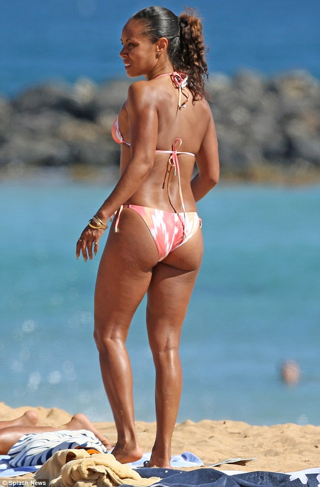 Her hard work is paying off! The 43-year-old actress showed off her washboard abs and shapely legs in the pink, yellow, and white number