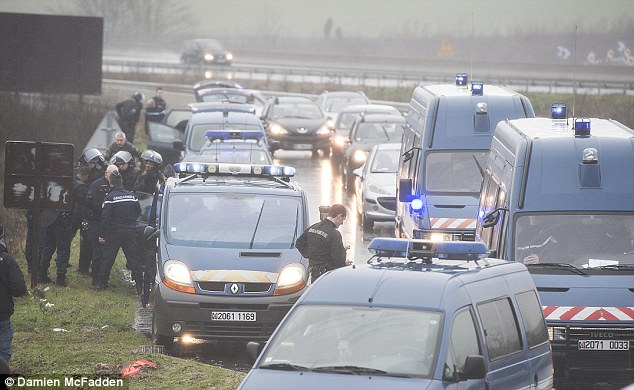 On the run: French police surrounded an area north-east of Paris where the armed men, who killed 12 people in Paris on Wednesday, were believed to be hiding