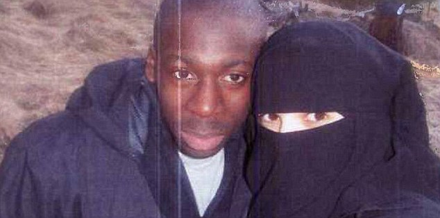Jihadi couple:Boumeddiene (right) walked away from a low-paid job as a cashier  in 2009 and started wearing a veil. She 'devoted herself' to Coulibaly (left)