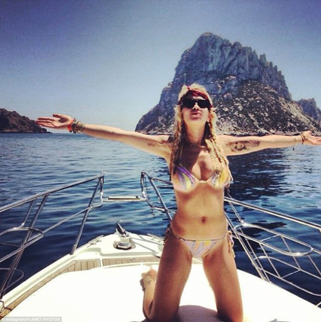 Rita is certainly living the high life - she is pictured here frolicking on a yacht in a skimpy bikini
