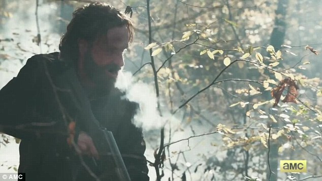 'Surviving together is all that matters': In the slow-motion preview, which premiered Friday, the hardened former sheriff's deputy brandished a rifle in a chilly Atlanta forest