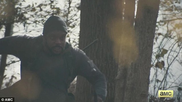 Non-violent at heart: Tyreese Williams (Chad Coleman) bounded down a hillside with a rifle on his back through the foggy forest