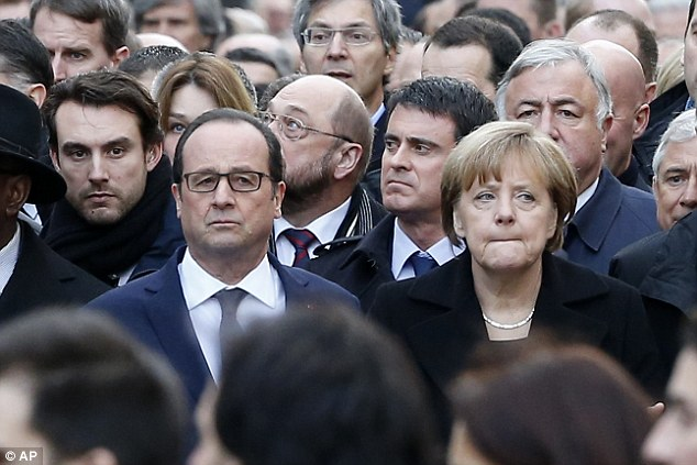 Support: French President Francois Hollande (left) and German Chancellor Angela Merkel (right) stand side by side in the march on Sunday