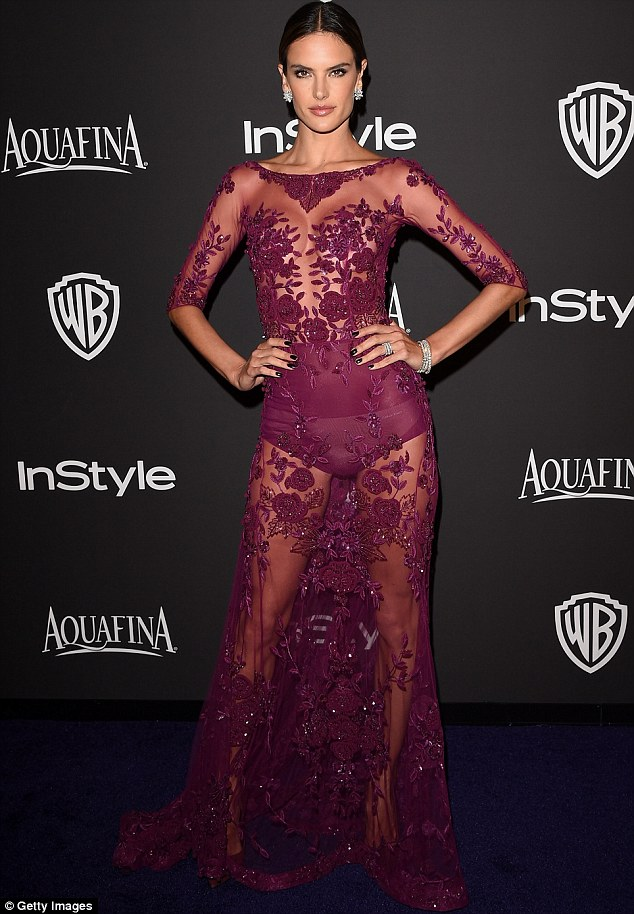 Brazilian beauty: Alessandra Ambrosio definitely turned heads at the gala as she donned a see through magenta-coloured ensemble