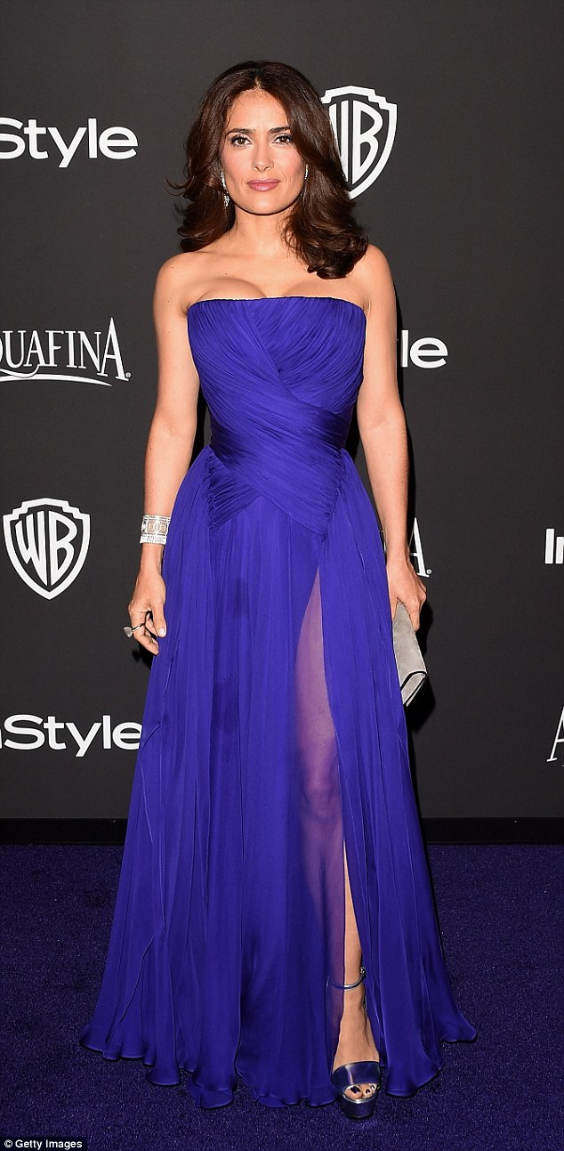 Leggy look: Salma Hayek cut a glamorous figure in her purple silk gown as she hit the 2015 InStyle And Warner Bros Golden Globes after-party