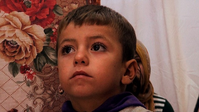 Refugee families: This little boy lives in a refugee camp where no woman or girl is safe from the attentions of Isis